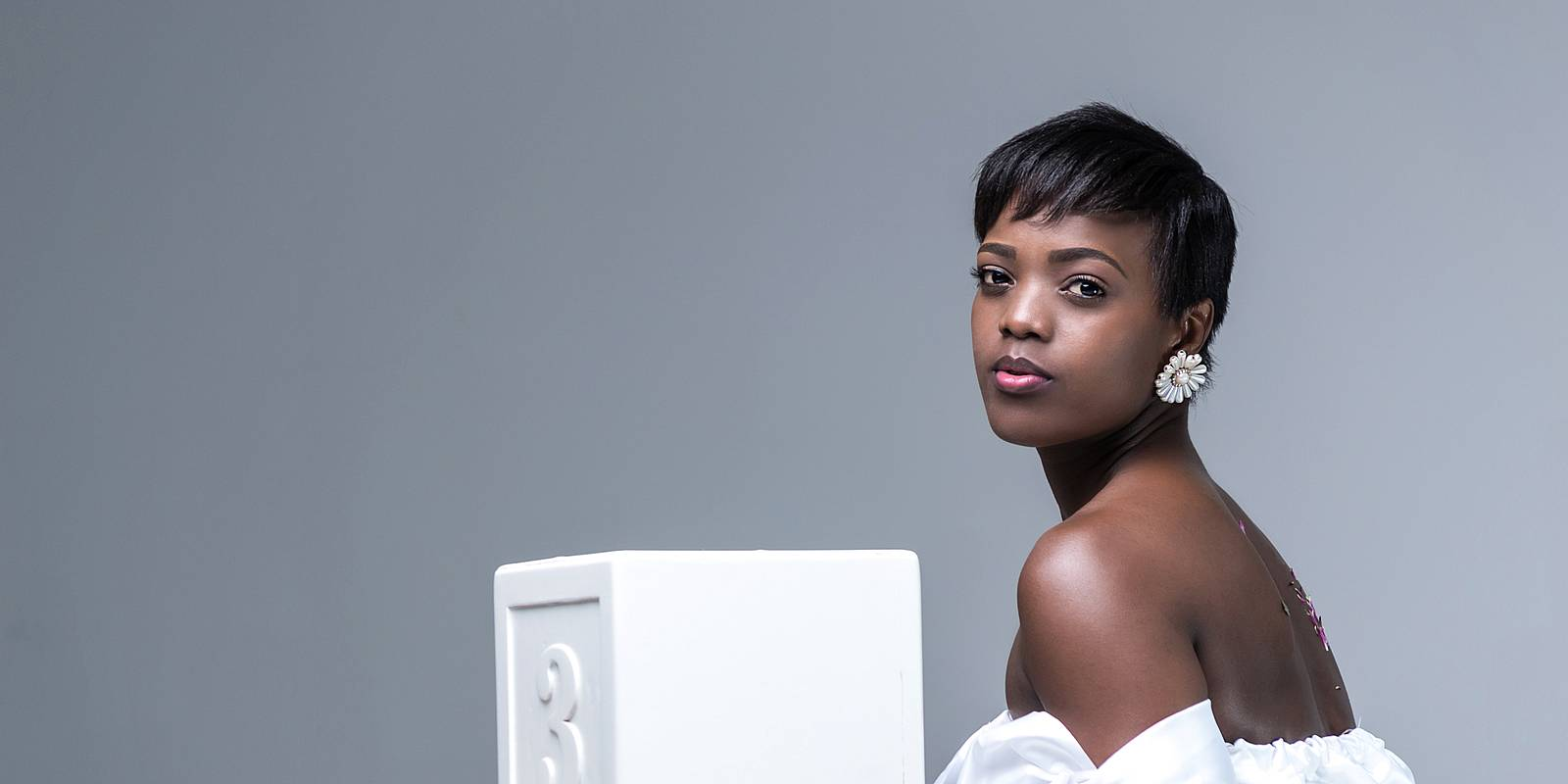 African Woman in white dress in sitting