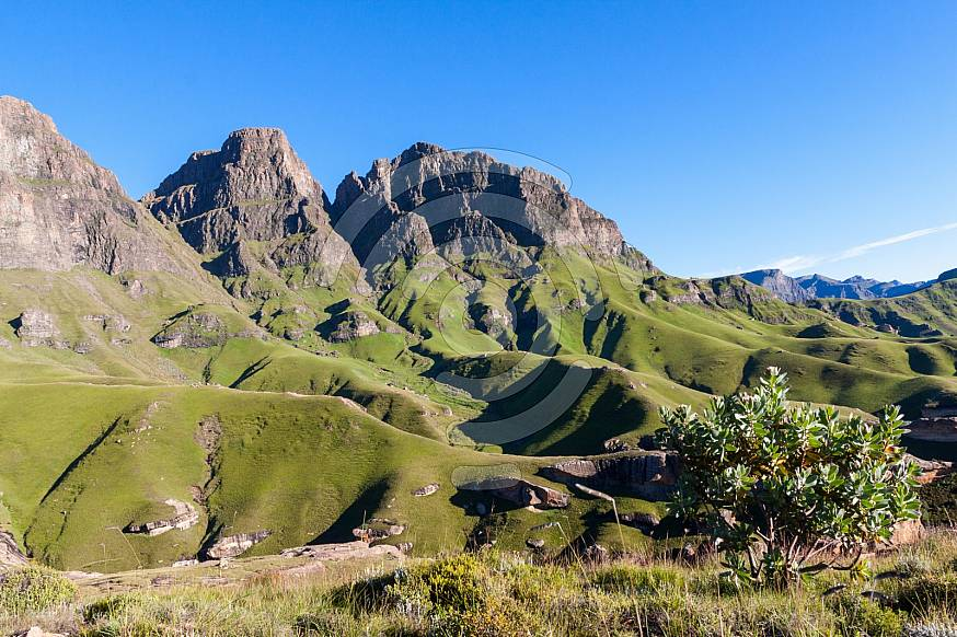 Beautiful green mountains with a clear blue sky