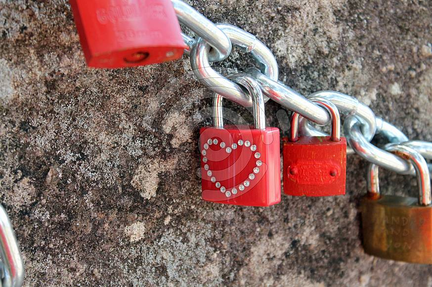 Red lock with a heart shape
